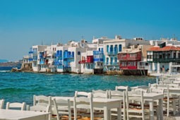 Alefkandra, Little Venice in Mykonos, Greece with cafe chairs at foreground